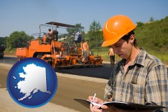 alaska map icon and a paving contractor with paving machinery