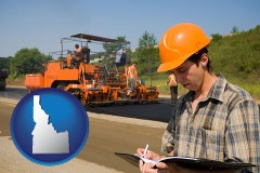 idaho map icon and a paving contractor with paving machinery