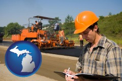 michigan map icon and a paving contractor with paving machinery