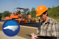 north-carolina map icon and a paving contractor with paving machinery