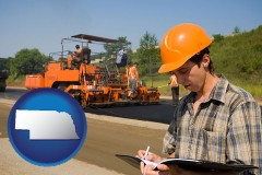 nebraska map icon and a paving contractor with paving machinery