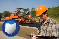 ohio map icon and a paving contractor with paving machinery