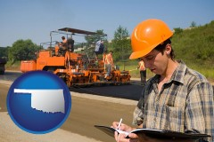 oklahoma map icon and a paving contractor with paving machinery