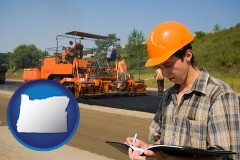 oregon map icon and a paving contractor with paving machinery