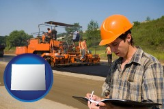 wyoming map icon and a paving contractor with paving machinery