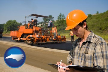 a paving contractor with paving machinery - with North Carolina icon